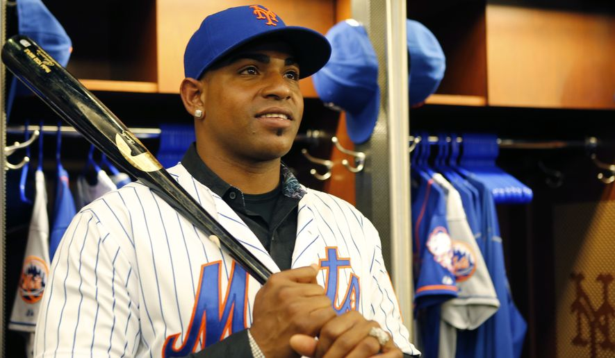 New York Mets outfielder Yoenis Cespedes poses for a photograph in the Mets clubhouse after a baseball press conference at CitiField in New York, Wednesday, Feb. 3, 2016, Cespedes signed a $75 million, three-year contract with the team. (AP Photo/Kathy Willens)