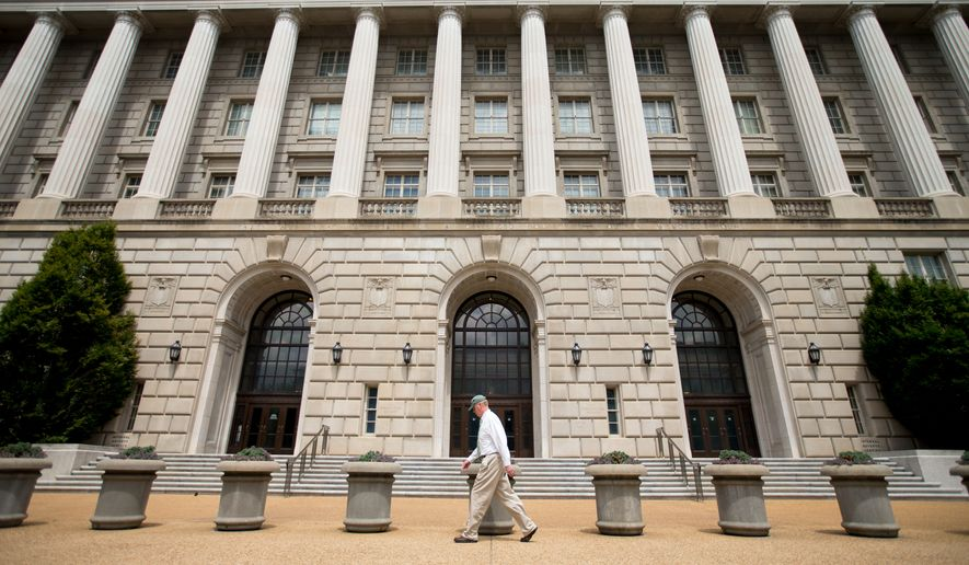 A man walks past the Internal Revenue Service Building in Washington. (Associated Press)