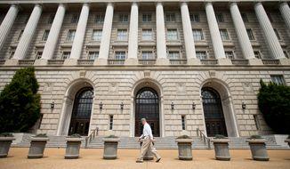 A man walks past the Internal Revenue Service Building in Washington. (Associated Press)