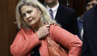 Center for Medical Progress investigator Sandra Merritt appeared before a judge in Harris County District Court on Wednesday on charges stemming from her involvement in the probe of Planned Parenthood Gulf Coast. She posted bond after it was reduced from $10,000 to $2,000. (Associated Press)