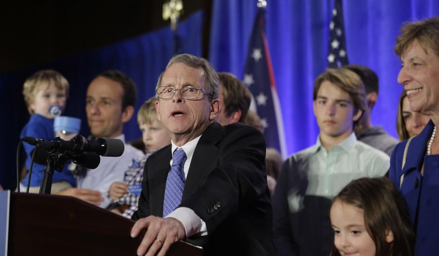 FILE - In this Nov. 4, 2014, file photo, Ohio Attorney General Mike DeWine speaks to supporters at the Ohio Republican Party's election night celebration in Columbus, Ohio. A review of emails and text messages obtained by The Associated Press through a public records request shows DeWine is in close contact with the anti-abortion group Ohio Right to Life. (AP Photo/Tony Dejak, File)