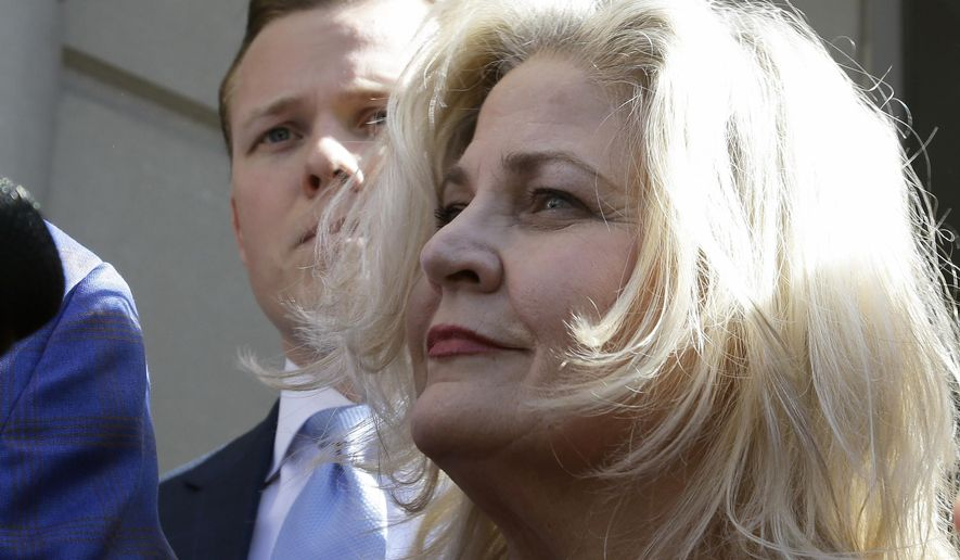 Sandra Merritt, one of the two anti-abortion activists indicted last month, stands outside the courthouse after turning herself in to authorities and bonding out  Wednesday, Feb. 3, 2016, in Houston.  Merritt and David Daleiden are charged with tampering with a governmental record, a felony punishable by up to 20 years in prison.   (AP Photo/Pat Sullivan)