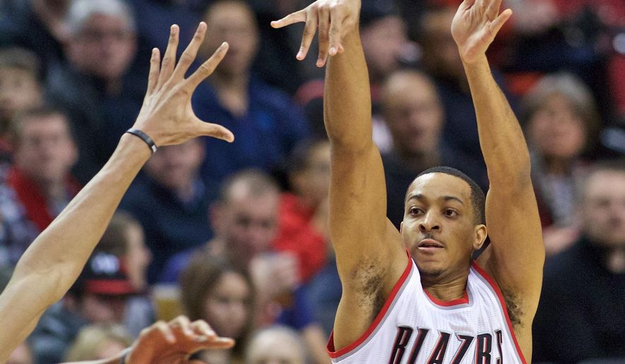 Portland Trail Blazers guard C.J. McCollum shoots against the Milwaukee Bucks during the second half of an NBA basketball game in Portland, Ore., Tuesday, Feb. 2, 2016. (AP Photo/Craig Mitchelldyer)