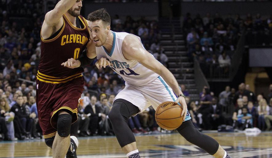 Charlotte Hornets center Frank Kaminsky, right, drives into Cleveland Cavaliers forward Kevin Love during the first half of an NBA basketball game Wednesday, Feb. 3, 2016 in Charlotte, N.C. (AP Photo/Nell Redmond)