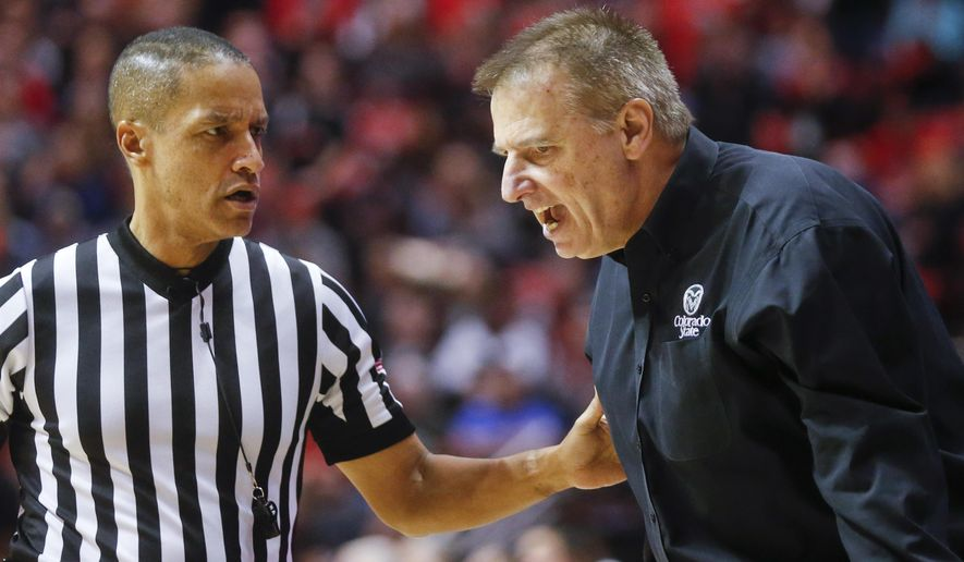 Colorado State coach Larry Eustachy disputes a call with a referee during the first half of an NCAA college basketball game against San Diego State on Tuesday, Feb. 2, 2016, in San Diego. (AP Photo/Lenny Ignelzi)