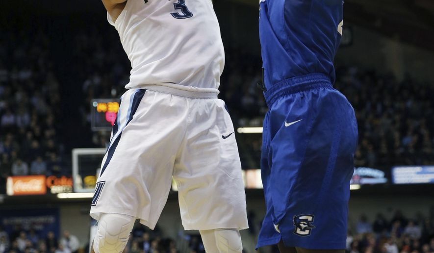 Villanova guard Josh Hart (3) takes a shot past Creighton guard Khyri Thomas (2) in the first half of an NCAA college basketball game, Wednesday, Feb. 3, 2016, in Villanova, Pa. (AP Photo/Laurence Kesterson)