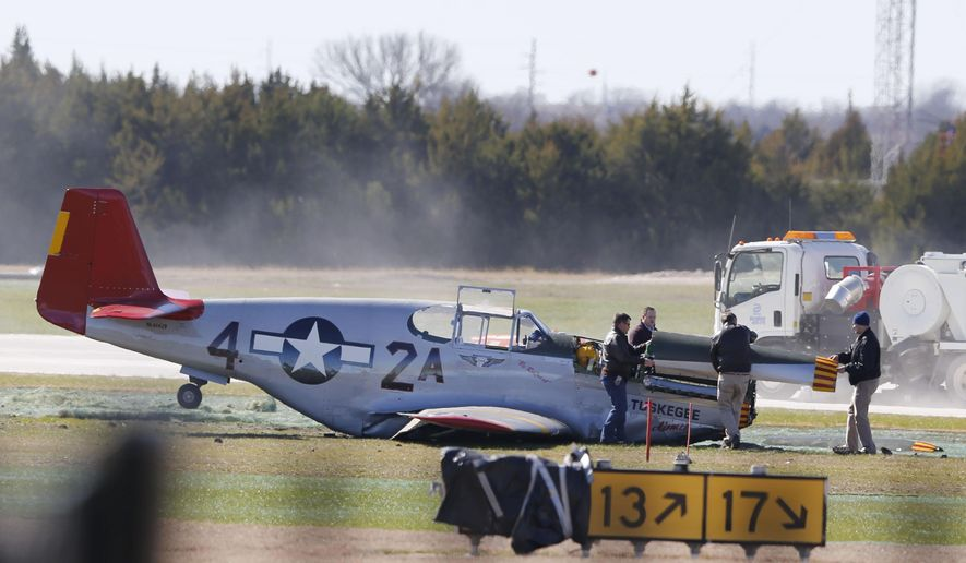 A single seat P-51C Mustang rests after making an emergency landing at Dallas Executive Airport in Dallas on Wednesday, Feb. 3, 2016. The World War II-era military plane has made a belly landing at the airport. Officials said the pilot wasn't injured. (Vernon Bryant/The Dallas Morning News via AP) MANDATORY CREDIT