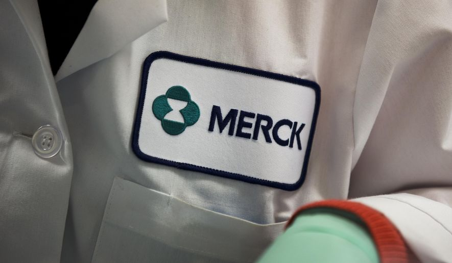FILE - In this Thursday, Feb. 28, 2013, file photo, a Merck logo is seen on a scientist's lab coat in West Point, Pa. Merck reports financial results on Wednesday, Feb. 3, 2016. (AP Photo/Matt Rourke, File)