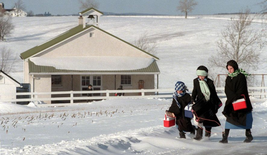 This Jan. 30, 2000 photo shows Amish children making their way home from their one-room schoolhouse on Snake Hill Road in Lancaster County, Pa. (Jack Leonard /LNP via AP) MANDATORY CREDIT