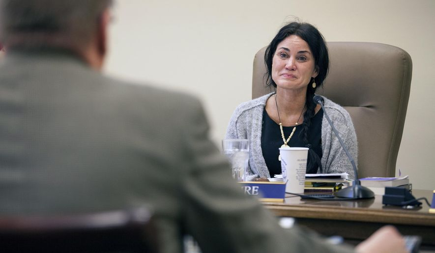 Sen. Lesil McGuire, listens to Sen. Bill Stoltze as the two discuss a potential Senate resolution calling for a convention to amend the U.S. Constitution to include a counterman, or veto, amendment on Wednesday, Feb. 3, 2016, in Juneau, Alaska.  The amendment, where it to be ratified, would allow states to propose countermand initiatives which - upon approval by three-fifths of the state legislatures - will repeal any federal statute, executive order, judicial decision or regulatory decision listed in the initiatives.  (AP Photo/Rashah McChesney)
