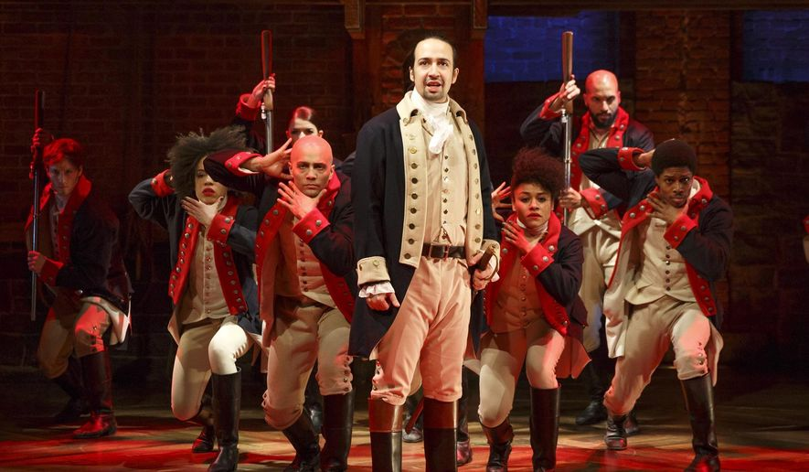 "This image released by The Public Theater shows Lin-Manuel Miranda, foreground, with the cast during a performance of ""Hamilton,"" in New York. The cast will perform at the Grammy Awards live via satellite from the Richard Rodgers Theatre in New York on Feb. 15.  (Joan Marcus/The Public Theater via AP)"