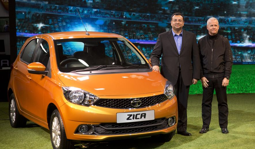 "Tata Motors Chairman Cyrus Mistry, left, and Tim Leverton, head of Tata Engineering and Research and Development, pose for photographers during the unveiling of Zica at a press preview of Auto Expo in Greater Noida, near New Delhi, India, Wednesday, Feb. 3, 2016. The Zika virus has hit India's Tata Motors, which has decided to rebrand soon-to-be launched hatchback vehicle which was to have been called Zica, an abbreviation of ""Zippy Car."" Tata Motors said in a statement Tuesday that the car would carry the Zica nameplate during the exhibition, but a new name will be announced in a few weeks. (AP Photo/Manish Swarup) (AP Photo/Manish Swarup)"