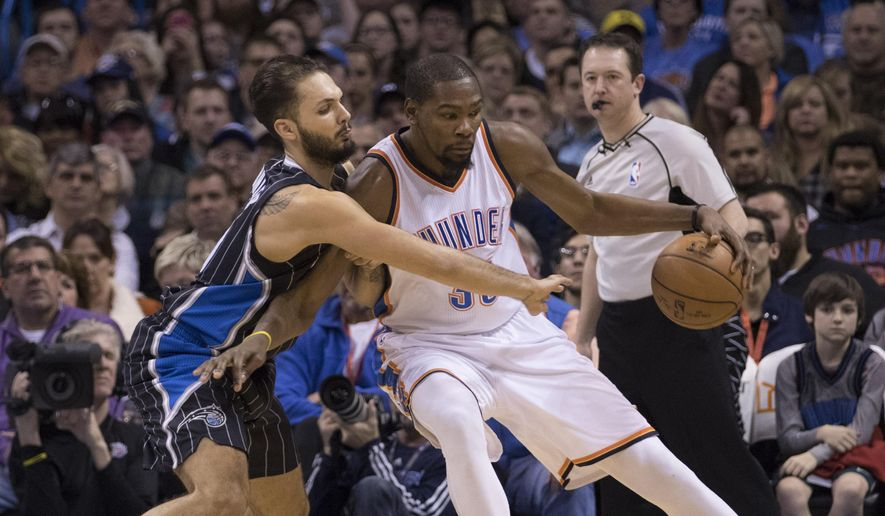 Orlando Magic guard Evan Fournier (10) tries to steal the ball from Oklahoma City Thunder forward Kevin Durant (35) during the first half of a NBA basketball game in Oklahoma City, Wednesday, Feb. 3, 2016. (AP Photo/J Pat Carter)