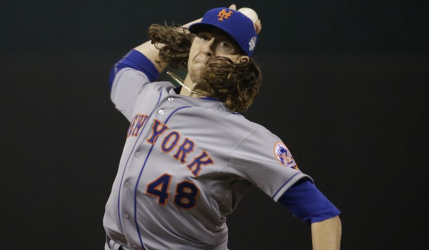 FILE - In this Wednesday, Oct. 28, 2015 file photo, New York Mets pitcher Jacob deGrom throws during the first inning of Game 2 of the Major League Baseball World Series against the Kansas City Royals in Kansas City, Mo. Now that most of this offseason's business is complete, the New York Mets may turn their attention to long-term deals for the hard-throwing young starting pitchers who helped the team reach the World Series for the first time since 2000, Wednesday, Feb. 3, 2016. (AP Photo/David Goldman, File)