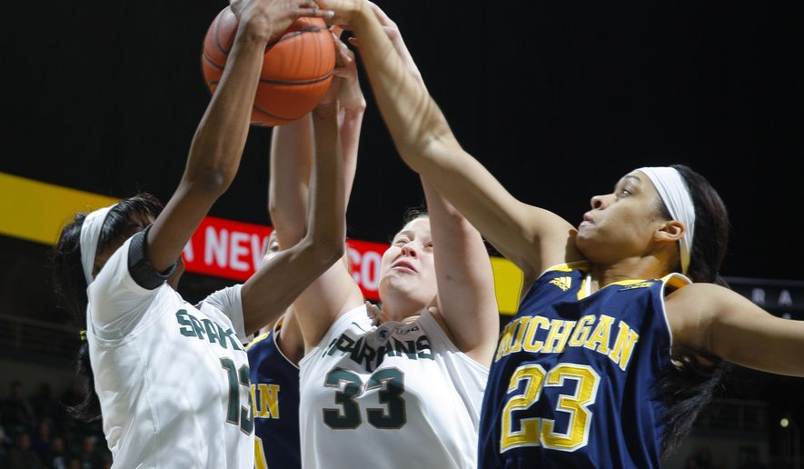 Michigan State's Morgan Green, left, and Jenna Allen (33) and Michigan's Maria Backman (23) vie for a rebound during the first quarter of an NCAA college basketball game Wednesday, Feb. 3, 2016, in East Lansing, Mich. (AP Photo/Al Goldis)