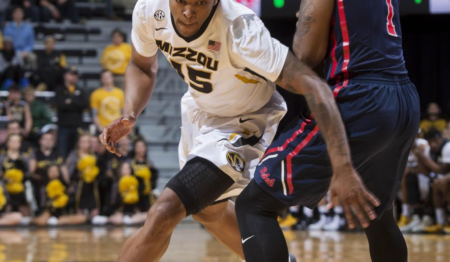 Missouri's Wes Clark, left, dribbles around Mississippi's Martavious Newby during the first half of an NCAA college basketball game Wednesday, Feb. 3, 2016, in Columbia, Mo. (AP Photo/L.G. Patterson)