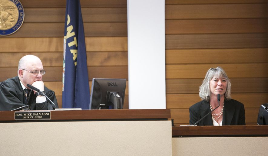 Kerrie Evans of Gardiner, Mont., right, testifies in District Judge Mike Salvagni's courtroom on Wednesday, Feb. 3, 2016, during her negligent birth civil trial at the Gallatin County Law and Justice Center in Bozeman, Mont. Evans is suing her health care providers because they failed to diagnose her unborn daughter's cystic fibrosis, denying her a chance to have an abortion. (Adrian Sanchez-Gonzalez/Bozeman Daily Chronicle via AP)