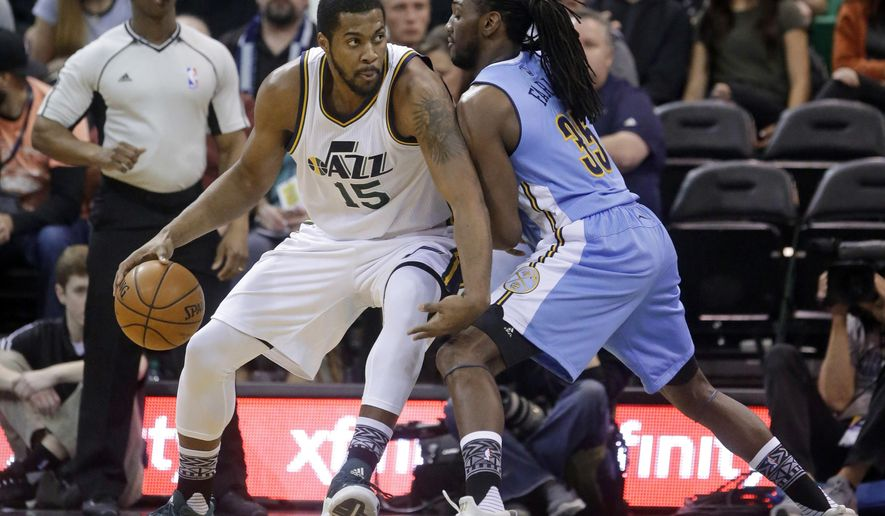 Denver Nuggets forward Kenneth Faried (35) guards Utah Jazz forward Derrick Favors (15) during the first quarter  of an NBA basketball game Wednesday, Feb. 3, 2016, in Salt Lake City. (AP Photo/Rick Bowmer)