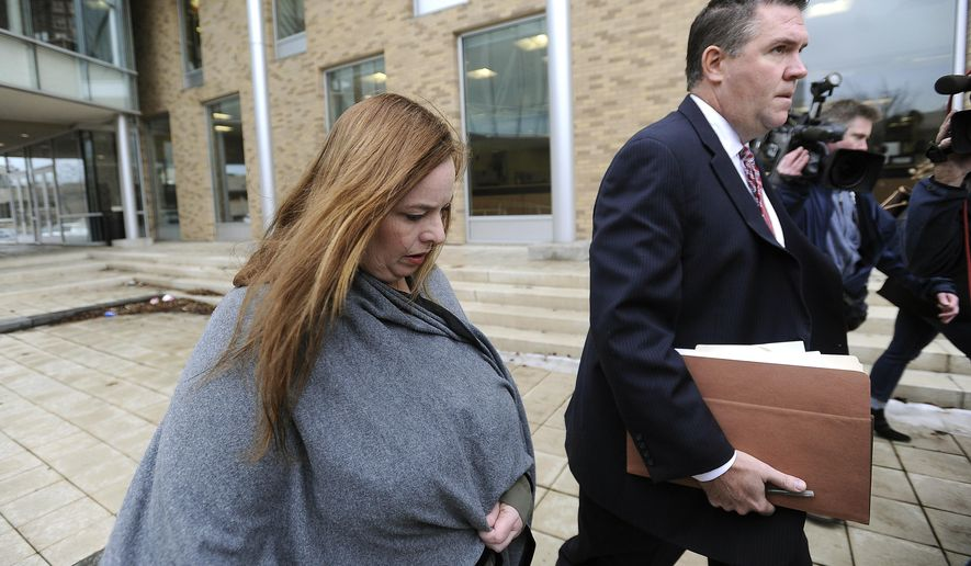 Melodie Gliniewicz, the wife of a disgraced Illinois police officer who staged his suicide, walks out the Lake County Courthouse with one of her lawyers after pleading not guilty to charges that she assisted her husband in siphoning money from a youth program, in Waukegan, Ill., Wednesday, Feb. 3, 2016, in Waukegan, Ill. (Mark Welsh /Daily Herald via AP) MANDATORY CREDIT; MAGS OUT, TV OUT