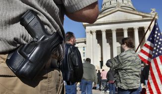 In this Jan. 19, 2013, photo, people from throughout Oklahoma gather into the south plaza at the state Capitol, in Oklahoma City to voice their support for their Second Amendment rights and to express concerns about proposed gun control legislation being considered by the federal government in the wake of the school shooting in Connecticut. (Jim Beckel/The Oklahoman via AP) **FILE**