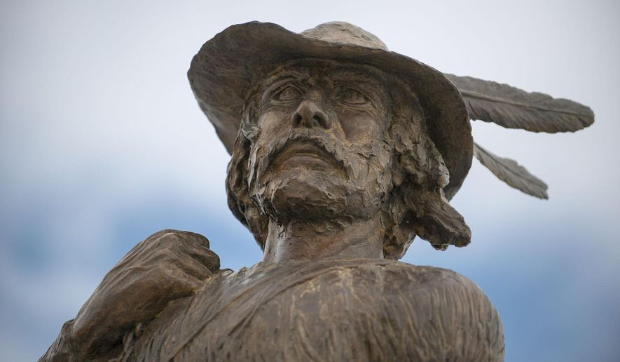 """Ott Jones' sculpture of Jim Bridger looks west from the Bozeman Chamber of Commerce on South 19th Avenue in Bozeman on Jan. 27, 2015. Bridger, depicted in the Oscar-nominated film """"The Revenant,"""" was a mountain man, trapper and scout that explored much of the Gallatin Valley and the West in the early 19th century. (Ben Pierce/Bozeman Daily Chronicle via AP)"""