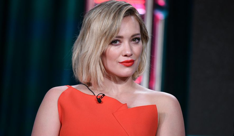 "FILE - In this Wednesday, Jan. 6, 2016 file photo, Hilary Duff speaks during the ""Younger"" panel at the TV Land 2016 Winter TCA in Pasadena, Calif. Court records show a Los  Angeles judge finalized Duff's divorce from ex-NHL player Mike Comrie on Thursday, Jan. 28, 2016. The pair were married in 2010 and separated in 2014 and have a three-year-old son together. (Photo by Richard Shotwell/Invision/AP, File)"