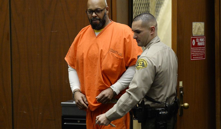 "In this April 30, 2015 photo, Marion ""Suge"" Knight is escorted into court for his arraignment on murder charges in Los Angeles. Court records show a Los Angeles judge on Friday, Jan. 29, 2016, cut off Knight's access to phone calls, visitors and mail from anyone except his attorneys at the request of sheriff's investigators. (Kevork Djansezian/Pool Photo via AP, File )"
