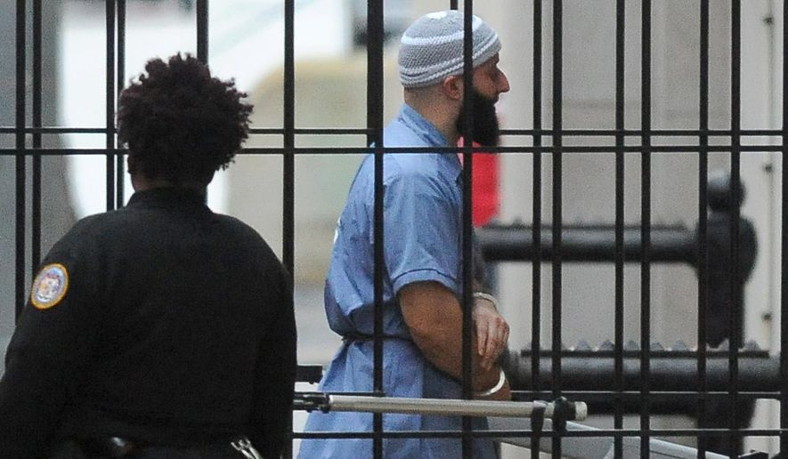 Adnan Syed enters Courthouse East in Baltimore prior to a hearing on Feb. 3, 2016 in Baltimore. (The Baltimore Sun via Associated Press)