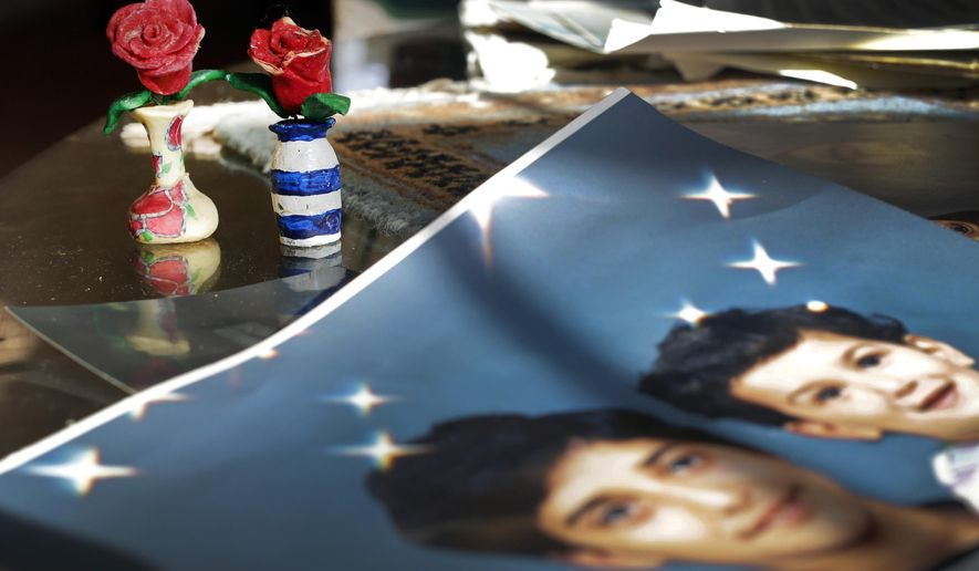 "FILE - In this  Dec. 10, 2014 file photo, prison artwork created by Adnan Syed sits near family photos in the home of his mother, Shamim Syed, in Baltimore. Adnan Syed, a convicted killer at the center of the first season of the podcast ""Serial,"" is scheduled to appear in court Wednesday, Feb. 3, 2016 as his attorneys argue for a new trial. (AP Photo/Patrick Semansky, File)"