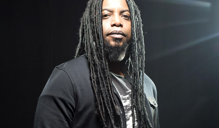 """In this Jan. 27, 2016 photo, Lajon Witherspoon, lead singer of Sevendust, poses for a portrait in New York. The Atlanta band is celebrating two decades together with their very first Grammy nomination for their song, """"Thank You."""" (Photo by Scott Gries/Invision/AP)"""