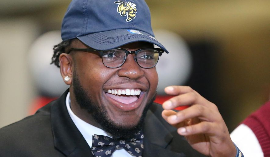 Grayson High School defensive tackle Chris Martin is all smiles sporting his Georgia Tech hat and bow tie during national signing day at the College Football Hall of Fame, Wednesday, Feb, 3, 2016, in Atlanta. (Curtis Compton/Atlanta Journal-Constitution via AP)  MARIETTA DAILY OUT; GWINNETT DAILY POST OUT; LOCAL TELEVISION OUT; WXIA-TV OUT; WGCL-TV OUT; MANDATORY CREDIT