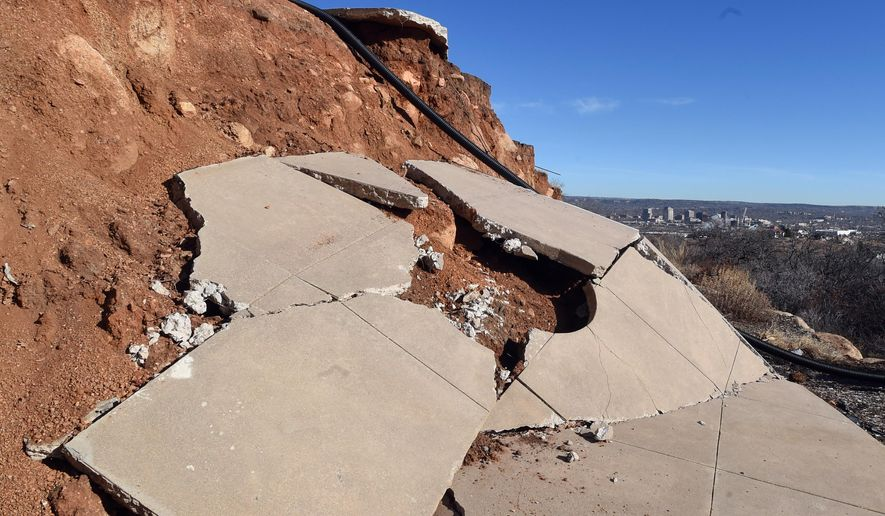 ADVANCE FOR SATURDAY, FEB. 6, 2016 AND THEREAFTER- This photo taken on Thursday, Jan. 28, 2016, shows what was a patio of Rick Sisco's home sliding down a hillside in Colorado Springs, Colo. Sisco's home in the Skyway neighborhood has been riding a landslide for months. It started as a crack, became a chasm, then a 13-foot cliff.  But because Sisco's circa-1964 home was built long before Colorado Springs passed its geological hazards ordinance, city officials know very little about the landslide that has ruined Sisco's property. (Jerilee Bennett/The Gazette via AP) MAGS OUT; MANDATORY CREDIT