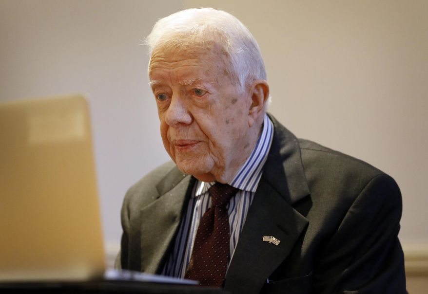 Former U.S. President Jimmy Carter listens during a video interview with The Associated Press via a laptop at a hotel in London, Tuesday, Feb. 2, 2016. (AP Photo/Kirsty Wigglesworth) ** FILE **