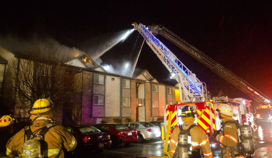 Crews from multiple fire departments battle a multiple unit fire in Spring Lake Twp, Mich., on Tuesday,  Feb. 2, 2016.   (Joel Bissell | Mlive.com)