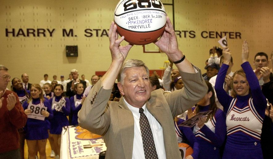 FILE - In this Dec. 1, 2004, file photo, McKendree College men's basketball coach Harry Statham raises a basketball over his head after his 880th career coaching victory in Lebanon, Ill.4.  Statham has won 1,088 games in 50 seasons and the next victory will break a tie with Tennessee women's legend Pat Summit for most ever by a coach at a four-year school. (AP Photo/Charles Rex Arbogast, File)