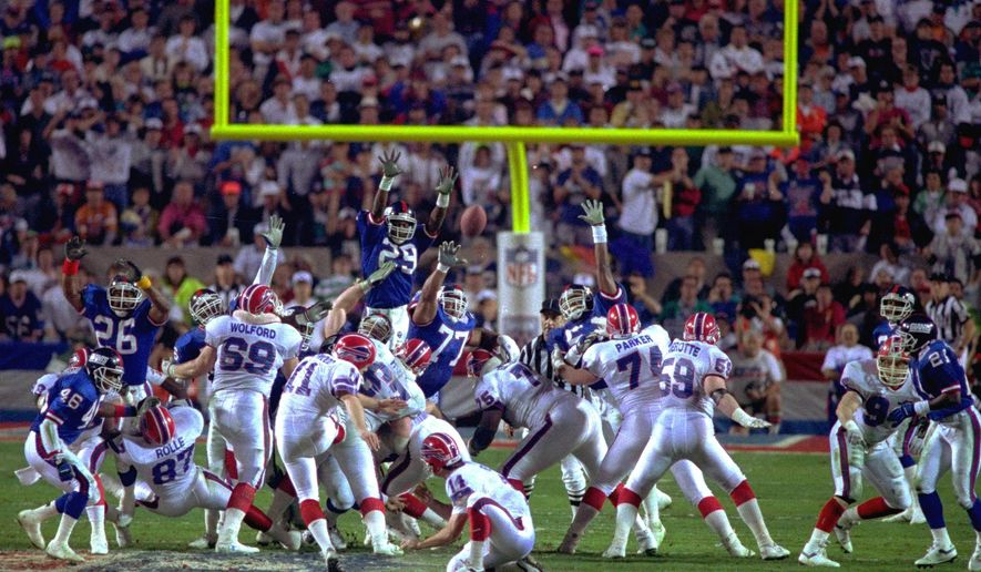 FILE - In this Jan. 27, 1991, file photo, Buffalo Bills kicker Scott Norwood, center, misses a field goal on the last play of the game, clinching the 20-19 victory for the New York Giants in Super Bowl XXV in Tampa, Fla. Despite the most famous miss in NFL history, Norwood was treated well by most Bills fans. They chanted his name until he addressed the crowd at a rally in Buffalo days after the loss. (AP Photo/Phil Sandlin, File)