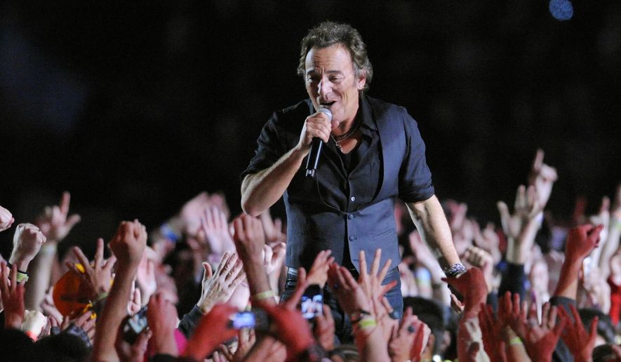 FILE - In this Feb. 1, 2009 file photo, Bruce Springsteen performs during halftime of the NFL Super Bowl XLIII football game between the Arizona Cardinals and the Pittsburgh Steelers in Tampa, Fla. The halftime show has become one of the year's top cultural moments, so anticipated that it is commonly seen by more people than the game itself.  (AP Photo/Mark J. Terrill, File)