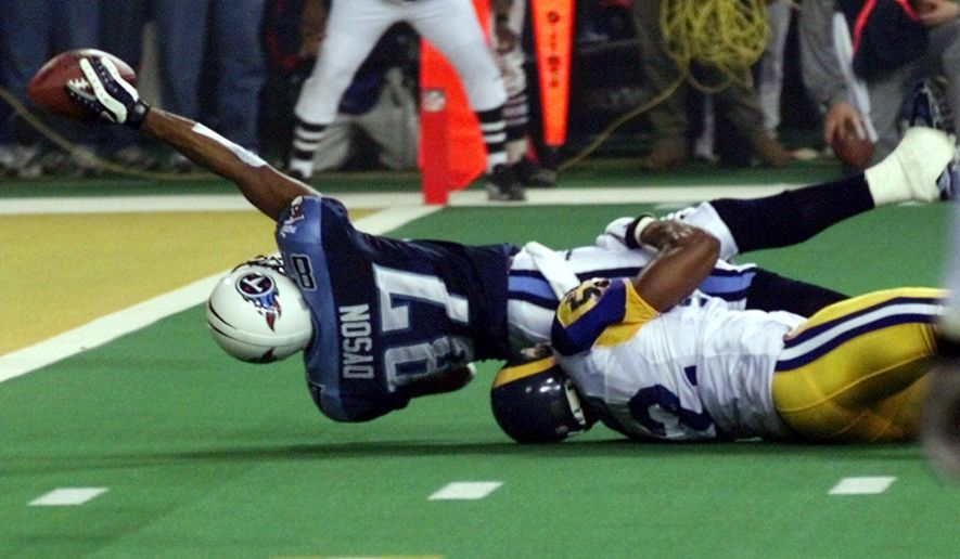 FILE - In this Jan. 30, 2000, file photo, Tennessee Titans wide receiver Kevin Dyson (87) tries but fails to get the ball into the end zone as he is tackled by St. Louis Rams' Mike Jones on the final play of NFL football's Super Bowl XXXIV in Atlanta. The Rams won 23-16. (AP Photo/John Gaps III, File)
