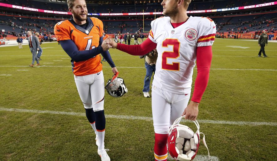 FILE - In this Nov. 15, 2015, file photo, Denver Broncos punter Britton Colquitt, left, shakes hands with his brother Kansas City Chiefs punter Dustin Colquitt following an NFL football game in Denver. Like his father, Britton has a chance to win his own ring Sunday when his Broncos face the Carolina Panthers in Super Bowl 50. Their dad Craig Colquitt won two Super Bowls with the Pittsburgh Steelers. (AP Photo/Jack Dempsey, File)