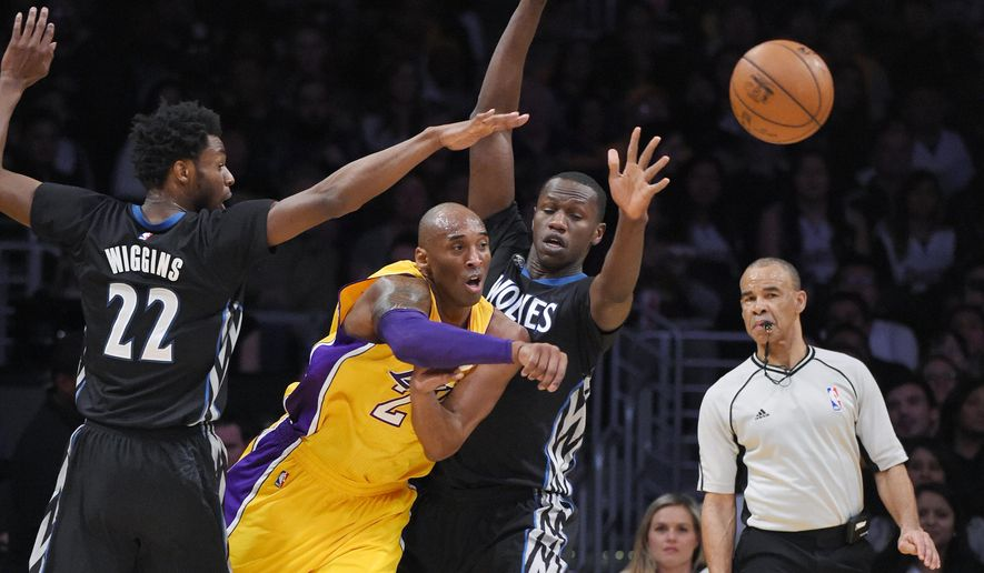 Los Angeles Lakers forward Kobe Bryant, second from left, passes the ball as Minnesota Timberwolves guard Andrew Wiggins, left, and center Gorgui Dieng defend during the first half of an NBA basketball game Tuesday, Feb. 2, 2016, in Los Angeles. (AP Photo/Mark J. Terrill)
