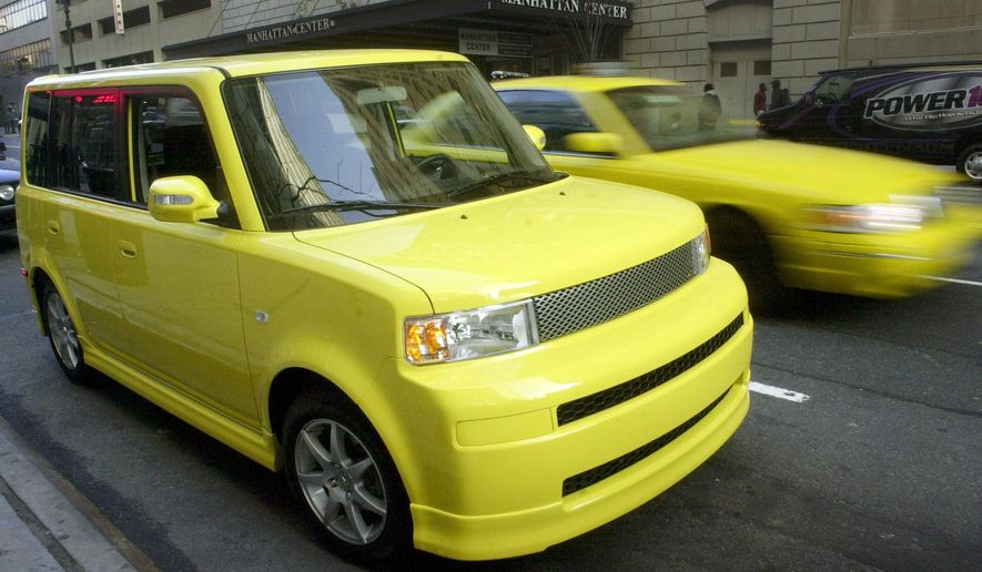 FILE - In this Saturday, April 16, 2005, file photo, a solar yellow Scion limited-production xB Release Series 2.0 is parked in Manhattan as part of a corporate promotion in New York. Toyota announced Wednesday, Feb. 3, 2016, that it is discontinuing its Scion brand, aimed at younger car buyers, after years of slumping sales. Scion owners can still visit Toyota service departments for maintenance and repairs. (AP Photo/Mark Lennihan, File)