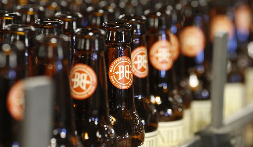 In this Thursday, Jan. 21, 2016, photograph, empty bottles head down the line to be washed in the factory of Breckenridge Brewery in Littleton, Colo. The entry of Anheuser-Busch InBev into Colorado's booming craft beer industry has some independent brewers concerned that they may be squeezed out of the market.(AP Photo/David Zalubowski)