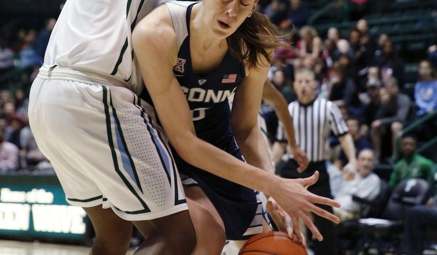 Connecticut forward Breanna Stewart (30) battles under the basket against Tulane center Chinwe Duru during the first half of an NCAA college basketball game in New Orleans, Wednesday, Feb. 3, 2016. (AP Photo/Gerald Herbert)