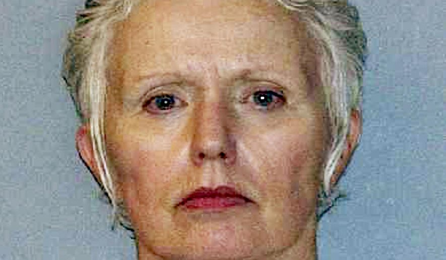FILE - This undated file photo provided by the U.S. Marshals Service shows Catherine Greig, longtime girlfriend of Whitey Bulger, who was captured with Bulger in 2011 in Santa Monica, Calif. Greig already is serving an eight-year prison term for helping Bulger avoid capture. She is expected to plead guilty in federal court in Boston Wednesday, Feb. 3, 2016, to a criminal contempt charge for refusing to testify before a grand jury investigating whether other people helped Bulger during his 16 years on the run. (AP Photo/U.S. Marshals Service, File)