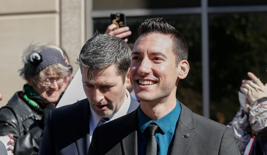 David Daleiden, one of the two pro-life activists indicted last week, turned himself in to authorities on Thursday in Houston. Mr. Daleiden and Sandra Merritt are charged with tampering with a governmental record, a felony punishable by up to 20 years in prison. (Associated Press)