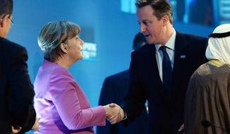 German Chancellor Angela Merkel shakes hands with Prime Minister David Cameron, right, at the 'Supporting Syria and the Region' conference at the Queen Elizabeth II Conference Centre in London, Thursday Feb. 4, 2016. Leaders and diplomats around the world are meeting in London Thursday and pledging some billions of dollars to help millions of Syrian people displaced by war, and try to slow the chaotic exodus of refugees into Europe. (Stefan Rousseau / Pool via AP)