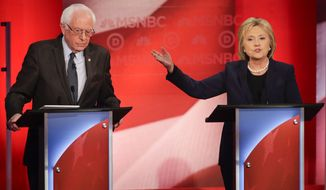 """At the last Democratic debate before New Hampshire voters go to the polls next Tuesday, Hillary Clinton said Sen. Bernard Sanders' campaign is based on the """"artful smear"""" of trying to convince Democrats she isn't a true progressive. (Associated Press)"""