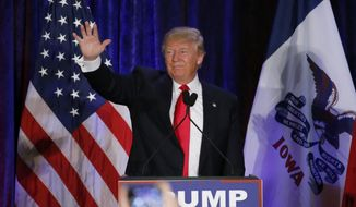 Republican presidential candidate, businessman Donald Trump waves after speaking at his caucus night rally, Monday, Feb. 1, 2016, in West Des Moines, Iowa. (AP Photo/Kiichiro Sato) ** FILE **
