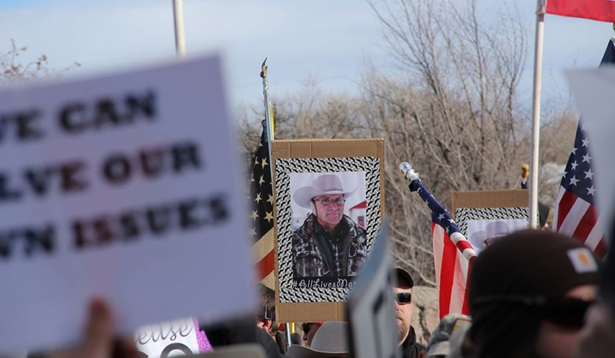 A sign is displayed with the picture of LaVoy Finicum as part of the demonstrations outside the Harney County Courthouse in Burns, Ore., Monday, Feb. 1, 2016. Hundreds gathered to protest and support the armed occupation of a national wildlife preserve. (Molly Young/The Oregonian via AP) MAGS OUT; TV OUT; NO LOCAL INTERNET; THE MERCURY OUT; WILLAMETTE WEEK OUT; PAMPLIN MEDIA GROUP OUT; MANDATORY CREDIT