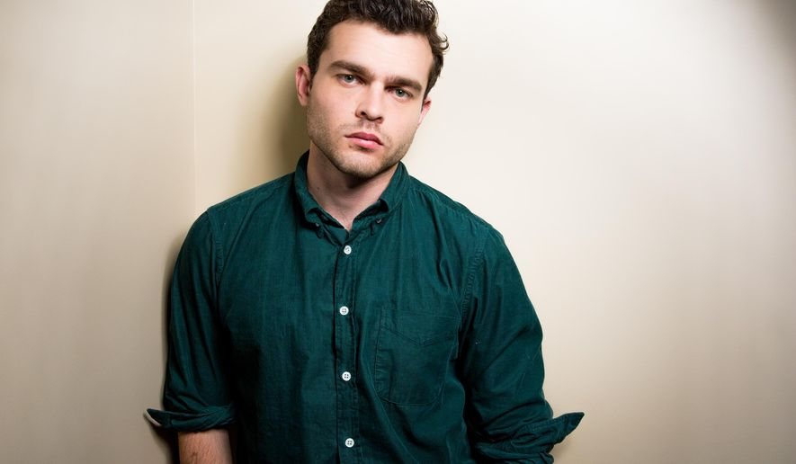 """In this Monday, Feb. 1, 2016 photo, Alden Ehrenreich poses for a portrait in Los Angeles. At the age of only 26, """"Hail, Caesar!"""" star Ehrenreich,  has already caught the attention of the Coens, Steven Spielberg, Francis Ford Coppola, Woody Allen and Warren Beatty. The film opens in U.S. theaters on Friday, Feb. 5. (Photo by Rich Fury/Invision/AP)"""